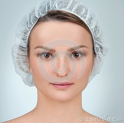 Woman face after plastic surgery. Anti-aging treatment and face lift.
