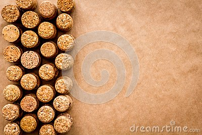 Wine bottle corks pattern on craft paper background top view copyspace. New Year celebration concept