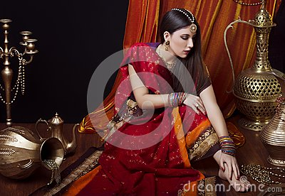 Beauty brunette Indian woman portrait. Hindu model girl with brown eyes. Indian girl in sari.