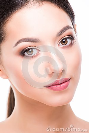 Beautiful Face of Young Woman with Clean Fresh Skin close up isolated on white. Beautiful Spa Woman Smiling. Perfect Fresh Skin. P