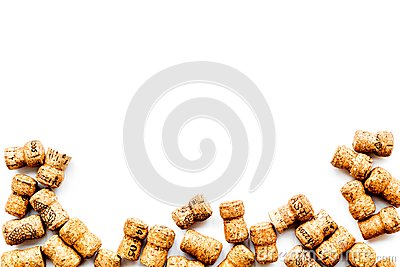 Wine bottle corks pattern on white background top view copyspace. New Year celebration concept