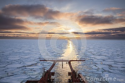 View from the aft of a research vessel crusing in ice during sun