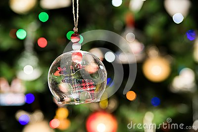 Glass bell of reindeer ornament hanging on Christmas tree