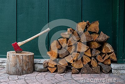 Red Axe and Pile of Fire Wood