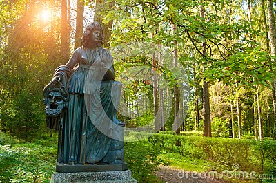 Bronze sculpture of Melpomene - the muse of tragedy, with a tragic mask. Pavlovsk, St Petersburg, Russia