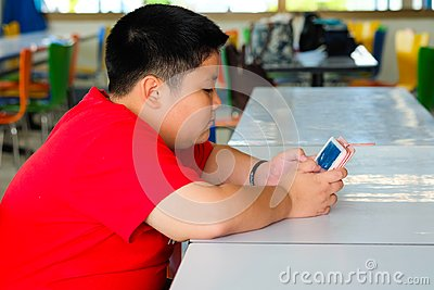 Child Boy are addictive playing tablet and mobile phones
