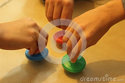 Jewish traditional chanuka toy. Children playing with colorful driedles.