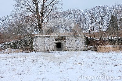 Root Cellar and Stone Wall in Winter