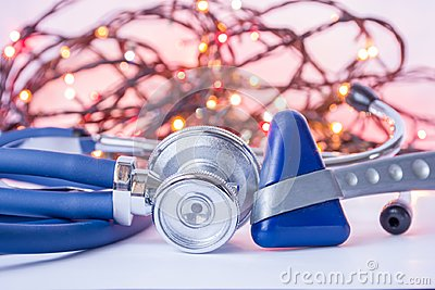 New Year and Christmas in neurology, internal medicine, general practice. Medical stethoscope and neurological reflex hummer in fo