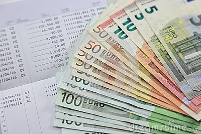Many euro banknotes and bank account passbook show a lot of transactions. concept and idea of saving money, investment