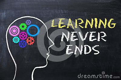 Learning never ends message on blackboard with human head shape and gears