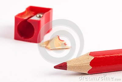 Close up Pencil sharpener and red wooden pencils on white backgroundpencils isolated on white background