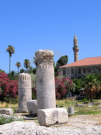 Antique greek columns and minaret of the mosque