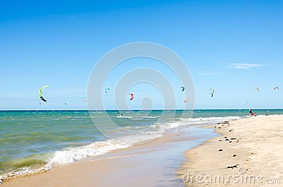 Several kite surfing on the air at the Cumbuco