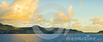 Panoramic view of St Kitts from the sea during golden hour at da