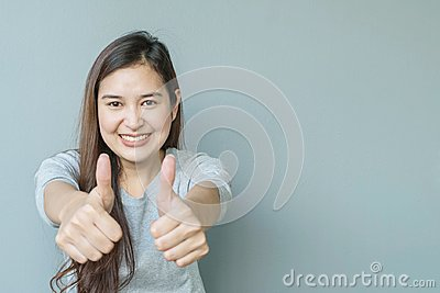 Closeup asian woman with admire motion with smile face on blurred cement wall textured background with copy space