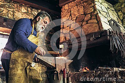 Senior blacksmith forge iron