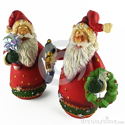 Two christmas figurine of santa claus
