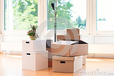 Many cardboard boxes in bright house during relocation