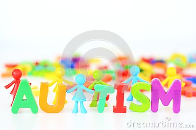 Mental health disorder, autism word with colored toys figurine on white background