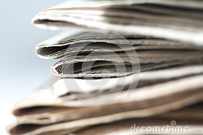 A bunch of folded newspaper close up shot.
