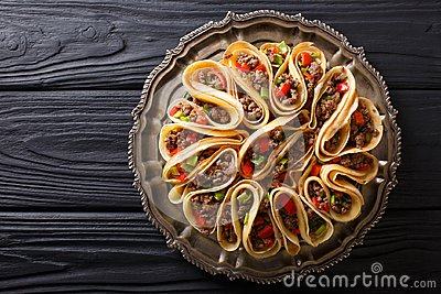 Tortilla stuffed with meat beef, peppers and onions closeup. Horizontal top view