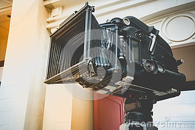 Close up of vintage classic mobile movie film projector with vintage color style. Old vintage rolling film cinema projector with c