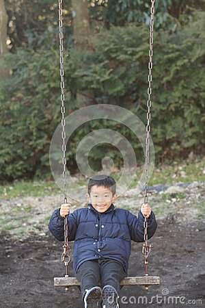 Japanese boy on the swing