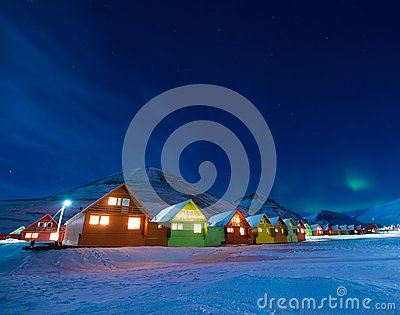 The polar arctic man Northern lights aurora borealis sky star in Norway Svalbard in Longyearbyen city moon mountains