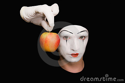 Portrait of  Mime with red apple