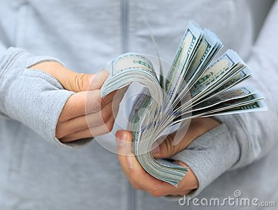 Female hands counting money