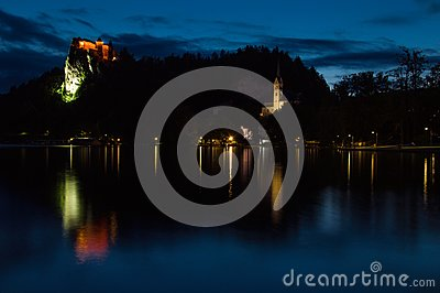 View of the lake and Bled Castle, sunset, reflection of the castle in the lake, Slovenia