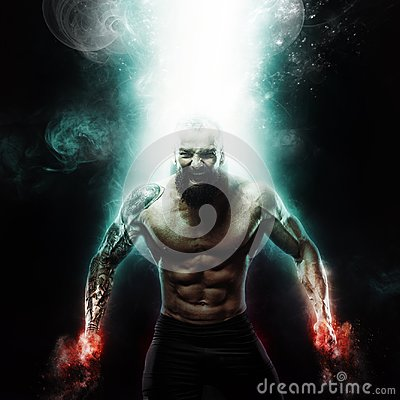 Sport and motivation wallpaper on dark background. Power athletic guy bodybuilder. Fire and energy