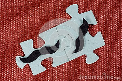 Close-up of two parts of puzzle. Symbolic men with a mustache. The concept of psychological compatibility, friendship.
