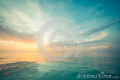 Relaxing and calm sea view. Open ocean water and sunset sky. Tranquil nature background. Infinity sea horizon
