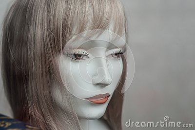 Woman face of mannequin with wig in fashion store sho