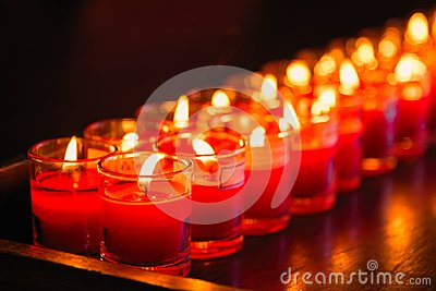 Burning candles at a Buddhist temple,Lighting of Praying candles
