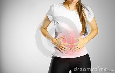 The young girl has a stomach ache. Pain in the abdomen. The pain