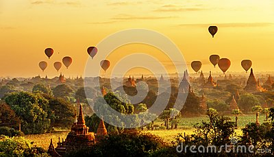 Sunrise view of beautiful pagodas and hot air balloons, Myanmar