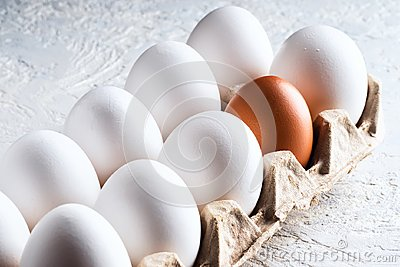 Pack egg white and one beige brown Concept harmful unnatural different other racism