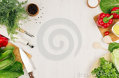 Healthy vegetarian ingredients for spring fresh green salad and kitchenware on white wood board, top view, copy space.