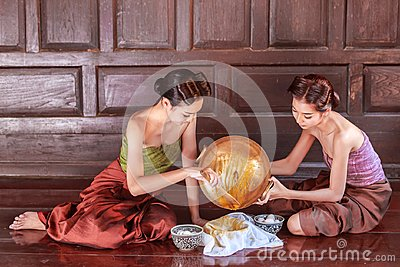 Portrait young asians women dressed in ancient Thailand are helping to make the dessert thai of Thai culture
