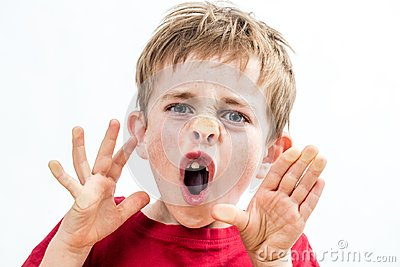 Screaming cheeky kid crushing his nose to window for misbehavior