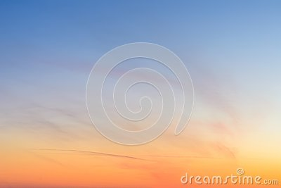 Sky and clouds at sunset, abstract colorful background, orange and blue.