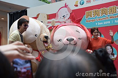Singapore Mediacorp artistes Chen Hanwei and Zoe Tay with mascots for Lunar New Year of the dog