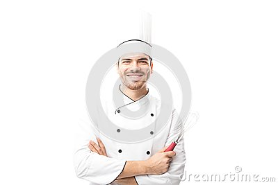 Chef holding a whisker and smiling
