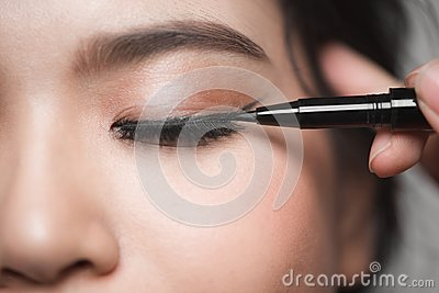 Beautiful woman with bright make up eye with black liner makeup