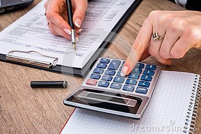 Woman filing individual income tax form 1040