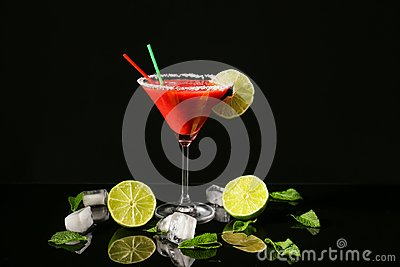 Glass of delicious strawberry daiquiri with lime