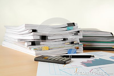 Stacks of documents on table